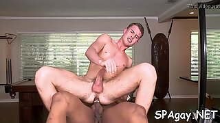 Hunk is stuffing gay boy with dildo previous to anal job