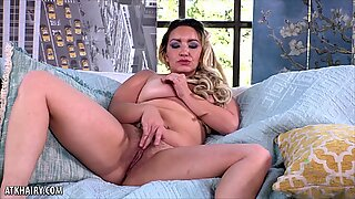 Curvy hairy blonde using a toy to cum on the couch